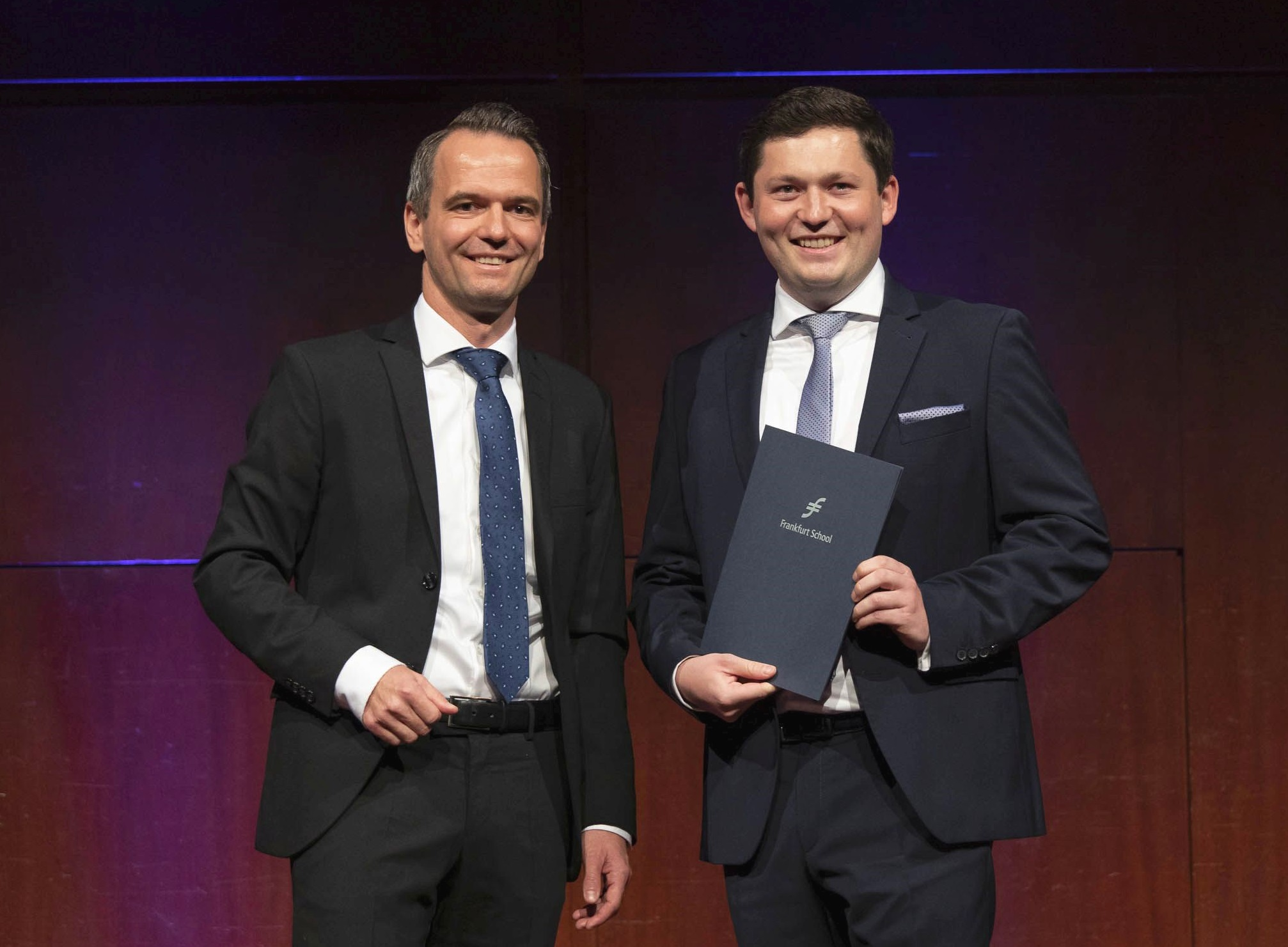 The head of HR at NORMA Group Jan Löffler presented the first-placed graduate Jonathan Hartel with the Manufacturing Management Award